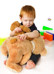 Nice kid with toy bear