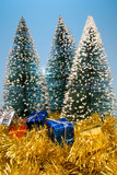 Holiday Christmas presents under evergreen pine trees. poster