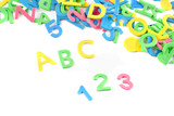pile of letters and numbers abc and 123s on a white poster
