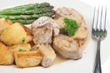 Pork medallions with sauteed pototoes and asparagus poster