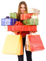 Beautiful woman holding many gift boxes and bags