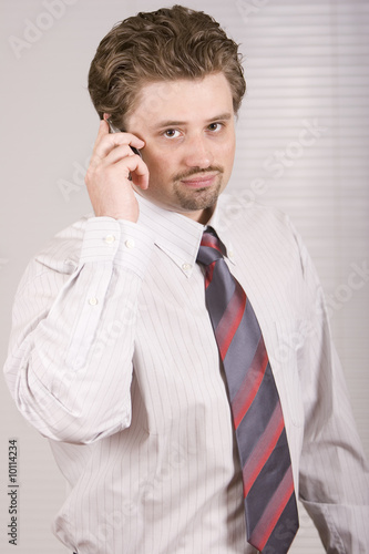 Young manager is speaking on the phone