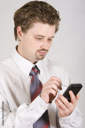 Young businessman is working on PDA