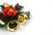 Christmas ornament with golden bells isolated on white.