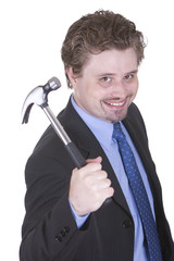 Young businessman is holding a hammer and ready for development