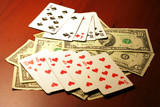 hand of the person with card for poker and rate in dollars poster