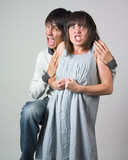 Furious young couple poster