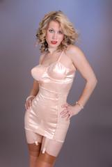 retro girl in fifties pink satin lingerie