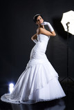 Young woman in wedding dress in studio environment poster