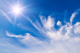 white fluffy clouds in the blue sunny sky poster