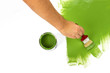 Green painting with a paint brush and paint can