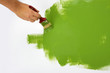 Green painting with a paint brush