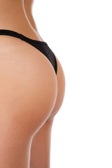 Profile of the back of a female wearing a black thong.