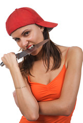 angry young woman wearing, holding a large knife in a mouth.
