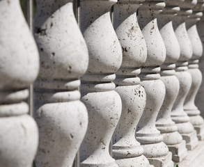 Ancient stone balustrade. Perspective view.