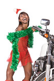 santa woman with long hair and red cap next to a bike,