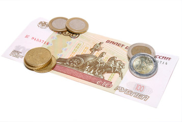 Hundred rubles under few coins of euro on white background