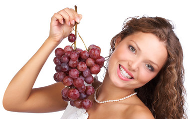 Beautiful young woman with bunch of grape..
