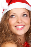 Fototapety Christmas woman in a Santa Cap. Isolated over white background.