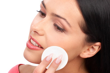 Pretty woman applying make up. Isolated over white background.