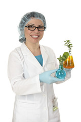 Scientist carrying plants cultivated in laboratory