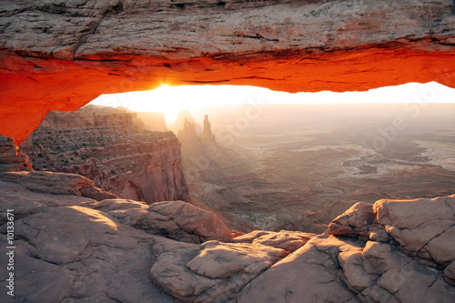 Sunrise at Mesa Arch in Utah's Canyonlands National Park. © Bryan Busovicki