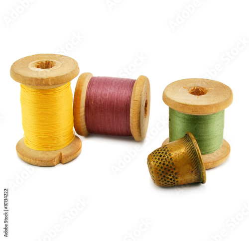 Spools of thread and thimble isolated on a white background