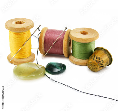 Spool of thread, thimble and needle isolated