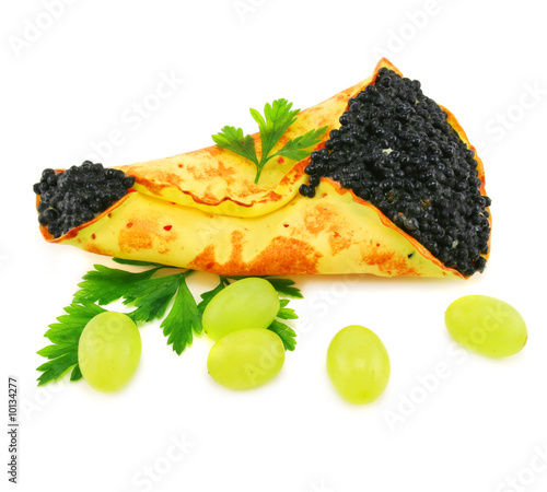 Caviar-stuffed pancake and grapes isolated