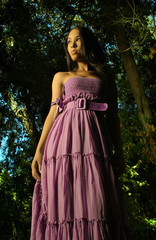 fashion shot of female model in purple dress