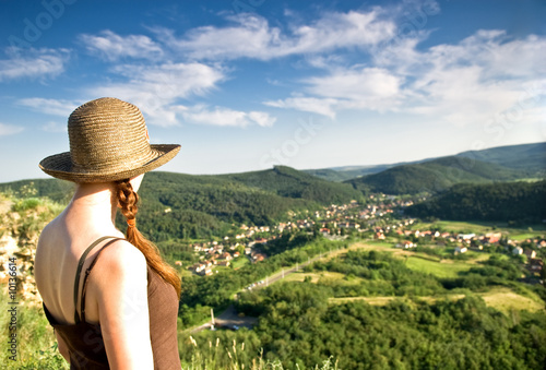 Woman looking from top of hill view, Castle Sirok, Hungary