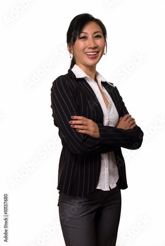 Asian woman in black business suit with arms crossed