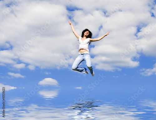 expressive young woman is flying