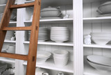 home dishes in cupboard and wooden stair poster