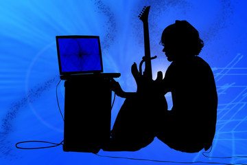 Teen boy with guitar, amp, computer.