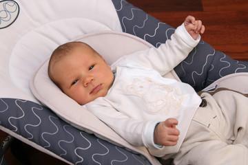 newborn baby in bouncer chair
