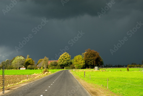 A road towards a dark autumn sky in the Netherlands