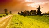 Fototapety beautiful sunset windmill landscape in the netherlands