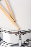 Fototapety A new silver snare drum with sticks on a white background