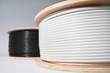 Two wooden spools with energy cable in macro view - 10145861