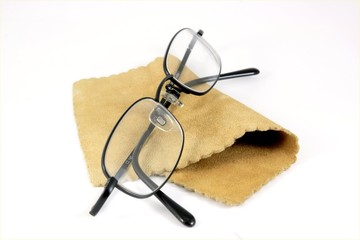 Pair of black-rimmed metal glasses or spectacles