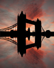 Tower Bridge London reflected in River Thames at sunset