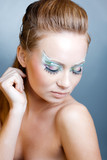 Fashion model with ceremonial make-up and face-art