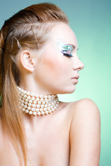 Fashion model in profile with ceremonial make-up