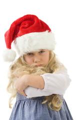 einen kleines mädchen mit weihnachtsmütze eingeschnappt