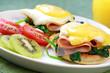 Eggs benedict.  Muffins, spinach, ham,  egg, Hollandaise sauce.