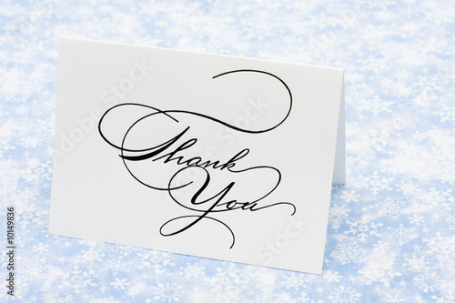Thank you card on blue snowflake background