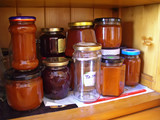Pots of homemade marmalade stocked in a cupboard poster