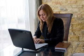 Girl working on laptop.