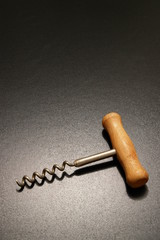 a corkscrew in dramatic lighting.